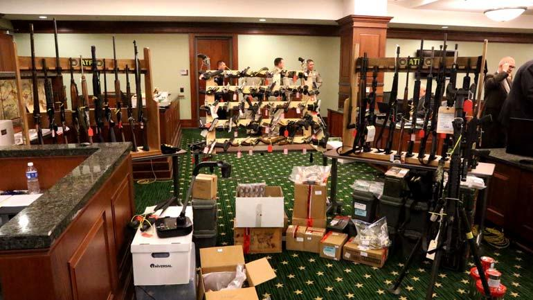 Evidence, inlcluding the weapons stockpile, as shown in court