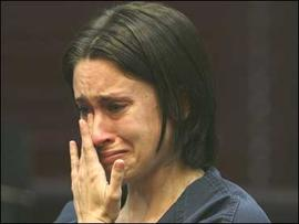 Casey Anthony wipes tears from her eyes at a bond hearing at the Orange County courthouse in Orlando, Fla.