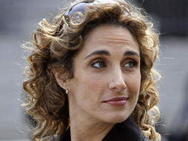 "Actress Melina Kanakaredes. of the CBS television series ""CSI:NY,"" stops while filming a 2007  episode in Foley Square, in New York. (AP Photo)"