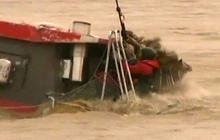 Dramatic River Rescue While Boat Sinks