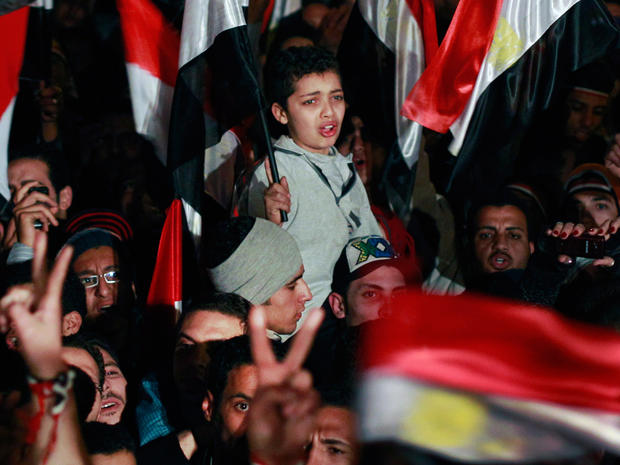 Egyptian boy cries with emotion as he and others celebrate