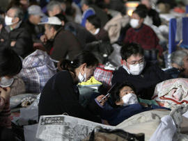 Survivors shelter at an evacuation center at Watari, Japan