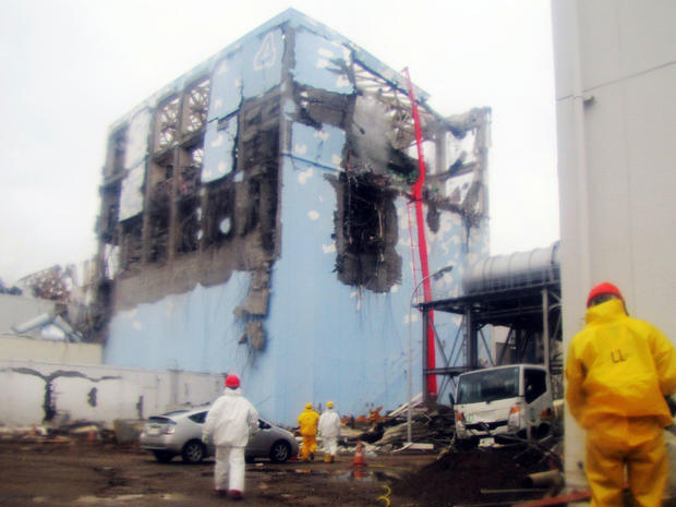 Workers spray water on reactor Number 4 at Fukushima Dai-ichi nuclear plant