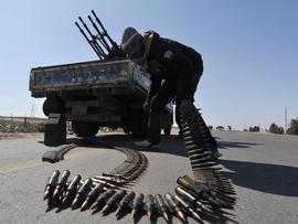 Rebel fighter mans anti-aircraft gun near Ajdabiya, Libya