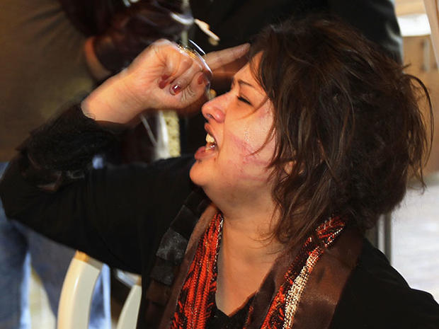 Iman Al-Obeidi is seen in Tripoli in this March 26, 2011 file photo, after storming into a hotel's breakfast room to show her wounds to foreign media.