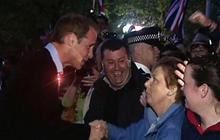 Prince William greets fans on the mall