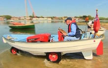 """""""Mow-ter boat"""" made from a lawnmower and boat"""