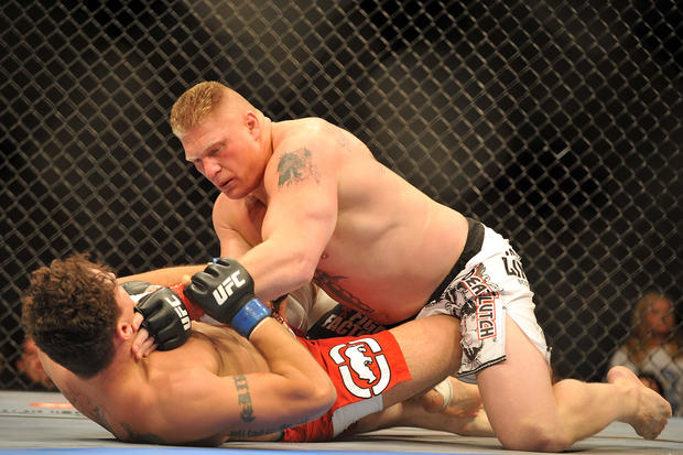 Brock Lesnar holds down Frank Mir during their heavyweight title bout during UFC 100 on July 11, 2009 in Las Vegas, Nevada.