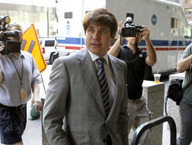 Former Illinois Gov. Rod Blagojevich arrives at a federal courthouse for a hearing in Chicago July 15, 2011. It is Blagojevich's first time in court since a jury convicted him of multiple corruption counts in June. Judge James Zagel warned Blagojevich that he could lose his Chicago home and a condo in Washington if he tried to flee or otherwise violated his bond terms.