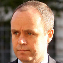 John Yates, an assistant commissioner in the Metropolitan Police Service and head of its specialist operations, arrives at the Cabinet Office Oct. 30, 2010, in London. Photo credit: Getty Images