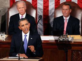 President Barack Obama delivers a speech to a joint session of Congress at the Capitol in Washington, Thursday, Sept. 8, 2011. Watching are Vice President Joe Biden and House Speaker John Boehner.
