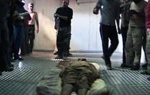 GRAPHIC VIDEO: Qaddafi's body on display in cooler
