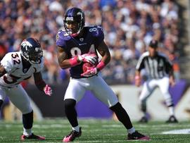 BALTIMORE, MD - OCTOBER 10: T.J. Houshmandzadeh #84 of the Baltimore Ravens makes a catch against the Denver Broncos at M&T Bank Stadium on October 10, 2010 in Baltimore, Maryland. Players wore pink in recognition of Breast Cancer Awareness Month. The Ravens lead the Broncos at the half 17-7. (Photo by Larry French/Getty Images)