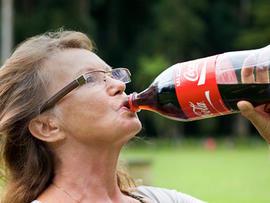 woman, senior, elderly, soda, sugary drink, drinking, coke, coca cola, stock, 4x3