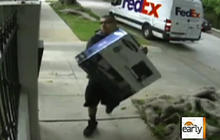 On tape: Apparent FedEx worker throws box over fence