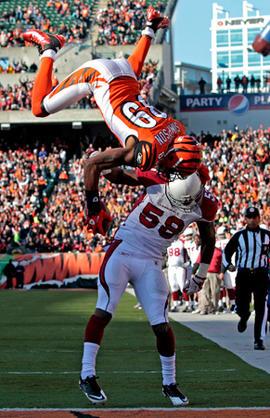 Jerome Simpson flips over Daryl Washington