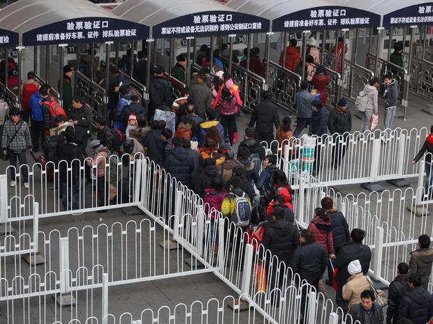 Passengers line up at Beijing West Railway Station