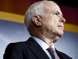 Sen. John McCain, R-Ariz., watches during a news conference on Capitol Hill Feb. 2, 2012, in Washington.