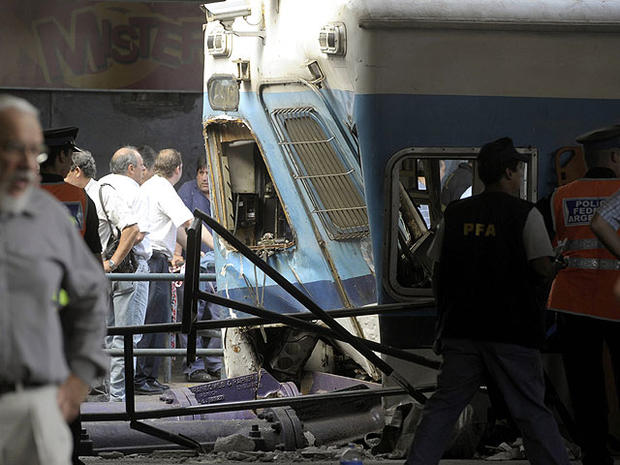 Police and rescue workers surround a train that crashed at Once train station in Buenos Aires on February 22, 2012.
