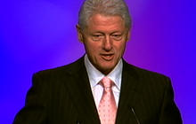 """Clinton: Romney's """"Daddy"""" turning over in his grave"""
