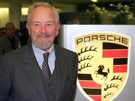 Picture taken on January 22, 1999 shows Ferdinand Alexander Porsche posing next to the logo of German sports car maker Porsche in Stuttgart, southern Germany. As the company announced on April 5, 2012, Ferdinand Alexander Porsche died at the age of 76. He was honorary chairman of the company's supervisory board and is known as designer of the company's iconic Porsche 911 car. AFP PHOTO / BERND WEISSBROD GERMANY OUT (Photo credit should read BERND WEISSBROD/AFP/Getty Images)