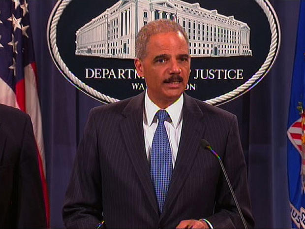 Attorney General Eric Holder speaks at a Department of Justice press conference announcing a government antitrust lawsuit against Apple Inc. and book publishers, April 11, 2012.