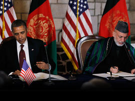 President Barack Obama and Afghan President Hamid Karzai sign a strategic partnership agreement at the presidential palace in Kabul, Afghanistan, Wednesday, May 2, 2012.