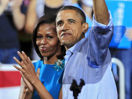 President Barack Obama waves with first lady Michelle Obama after a campaign rally