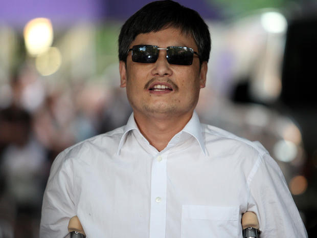 Chinese activist Chen Guangcheng speaks to the media upon arriving on the campus of New York University May 19, 2012, in New York City.