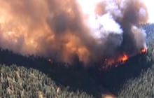 Massive Colo. wildfire growing by the minute