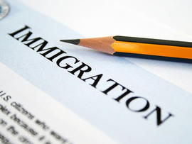 Close up of pencil on immigration application form.