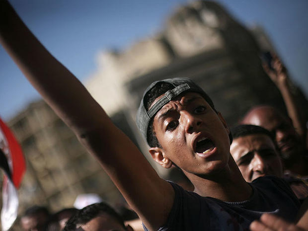 An Egyptian protester chats anti-Supreme Council for the Armed Forces (SCAF) slogans in Tahrir Square, Cairo, Egypt, June 21, 2012.