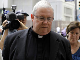 Monsignor William Lynn walks to the Criminal Justice Center June 22, 2012, in Philadelphia.