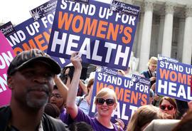 Supporters of US President Barack Obama's signature healthcare legislation celebrate