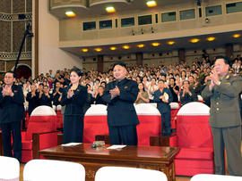 North Korean leader Kim Jong Un, center right, and others clap as they watch performance by North Korea's new Moranbong band in Pyongyang, North Korea, Friday, July 6, 2012.