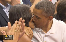 Obama, Michelle share kiss at Olympic basketball game