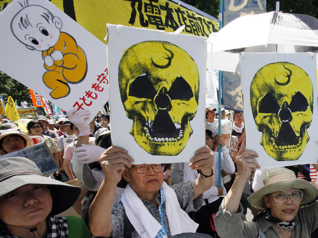 Protesters carry anti-nuclear placards during a march in Tokyo