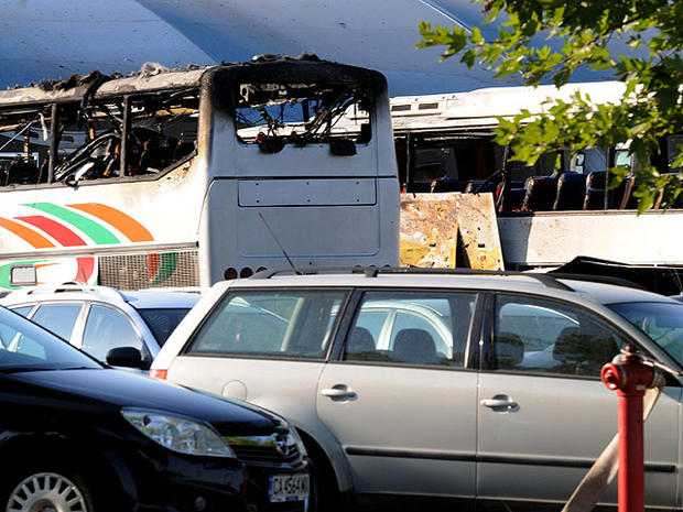 Destroyed buses are seen at Burgas airport, outside the Black Sea city of Burgas, Bulgaria, some 250 miles east of the capital, Sofia, Wednesday, July 18, 2012.