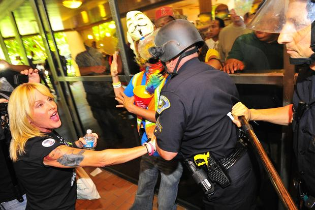 Riot police, protesters clash in Anaheim