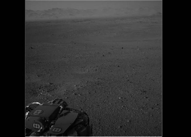 A view from one of Curiosity's navigation cameras shows the rim of Gale Crater, the rover's landing spot.