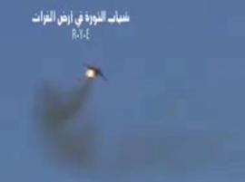 Syrian rebels claim this image, taken from a video, shows shows a government Soviet-made MiG warplane catching fire apparently after it was hit by ground fire. Syrian governments said the plane malfunctioned.