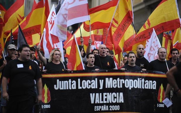 King Juan Carlos presides over National Day parade