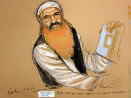 Khalid Sheikh Mohammed holds up a piece of paper during a court recess at a military tribunal pretrial hearing at the Guantanamo Bay Naval Base in Cuba, Oct. 15, 2012, in this picture of a sketch by courtroom artist Janet Hamlin and reviewed by the U.S. Department of Defense.