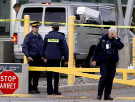 Police investigate a van at the scene of a shooting at the Blaine, Wash./Surrey, British Columbia border crossing Tuesday, Oct. 16, 2012.