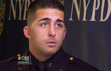 NYPD officer helps homeless man
