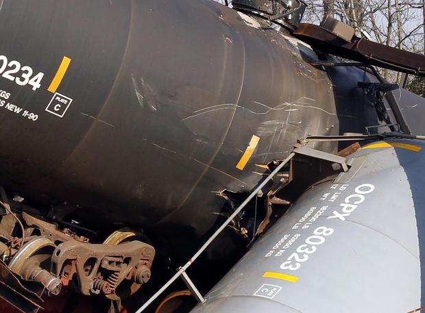 NJ train derailment tips tankers, sickens dozens