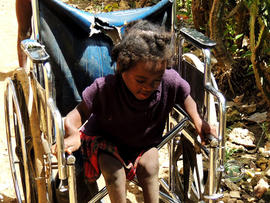 Jevaleen Benjamin, of Haiti, had been getting around on a broken wheelchair -- until she received her new PET.