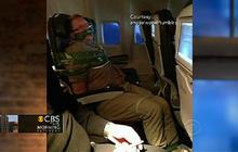 Drunk airplane passenger subdued