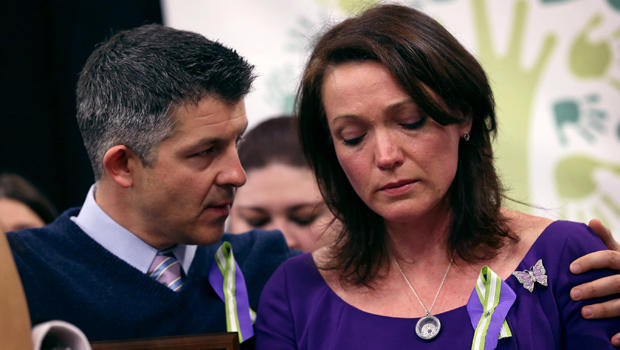 Ian Hockley and Nicole Hockley, parents of Sandy Hook massacre victim Dylan Hockley (6), embrace during a press conference with fellow parents of victims on the one month anniversary of the Newtown elementary school massacre on January 14, 2013 in Newtown, Connecticut.