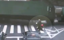 Truck nearly crushes motorcyclist, caught on tape
